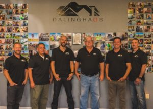 A photo of the team at Dalinghaus Construction, 6 men standing in front of their logo.