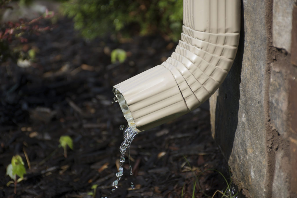 keeping downspouts in good repair can help your foundation
