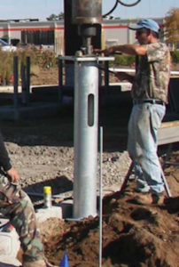 Worker installing ECP light pole foundation