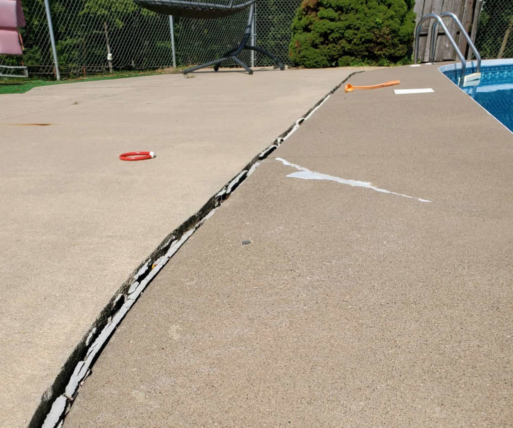 Pool deck concrete with vertical crack