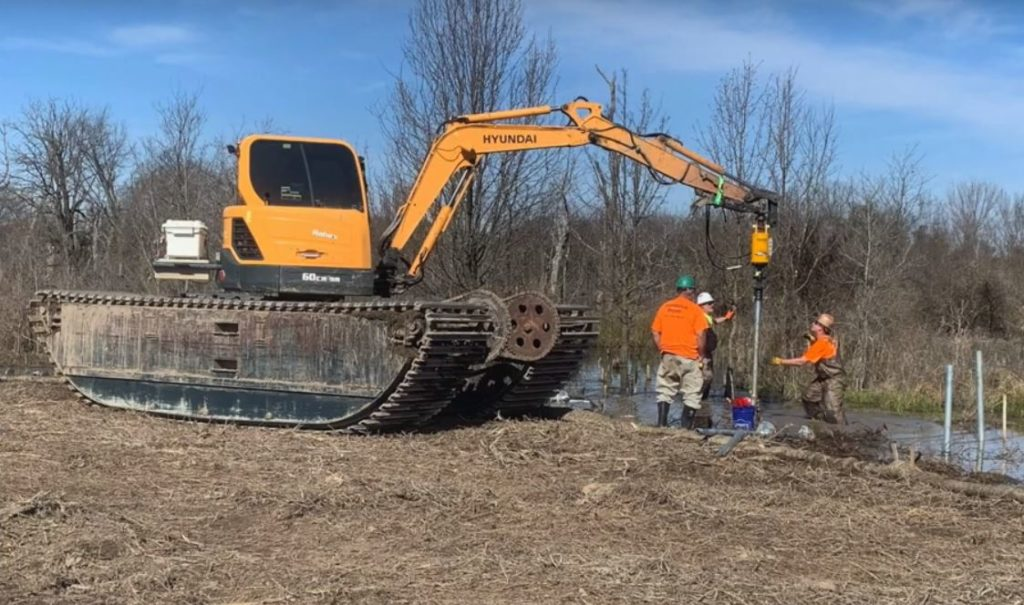Wetland excavator at work at Lake Bentonville, Arkansas.